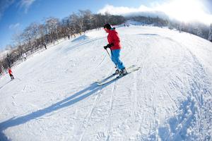 Snow banks help a skier learn to turn in Killington's TBL area.