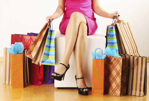 woman-sitting-with-shopping-bags