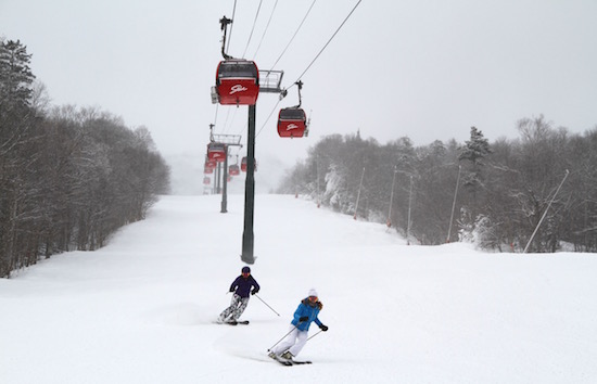 Me skiing Stowe with Heather Burke of LuxurySkiTrips.com.
