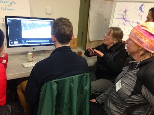 An instructor takes an attendee through videotape analysis.