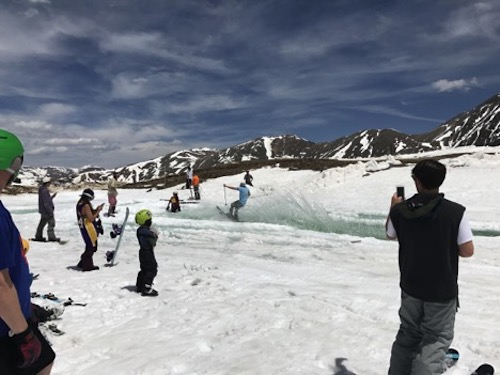 June 1, 2017: a crowd cheers on the skiers and riders during their pond skimming attempts.